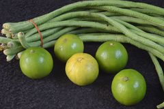 Lemons and long beans. Royalty Free Stock Photography