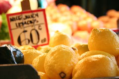 Lemons at the market. A bunch of lemons for sale at the Pike's Place Market in Seattle Stock Photography