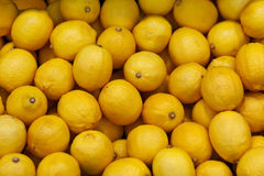 Lemons on the market counter - background Stock Photo