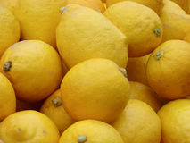 Lemons on the market for sale as a background. Selective focus royalty free stock images