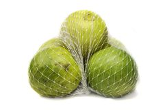 Lemons in mesh bag Royalty Free Stock Image
