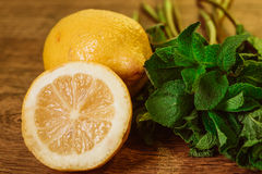 Lemons and mint on a dark wood background. tinting. selective focus Royalty Free Stock Photography