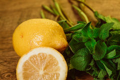 Lemons and mint on a dark wood background. tinting. selective focus Royalty Free Stock Photo