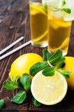 Lemons with mint and two glasses of ice tea Stock Image