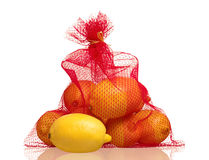 Lemons in net bag Royalty Free Stock Photography