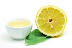 Lemons with oil Stock Photos