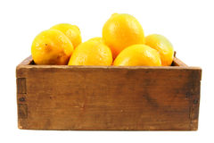 Lemons in an old box Royalty Free Stock Photos
