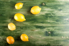 Lemons on the old table Stock Image