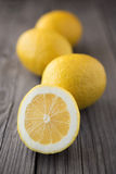 Lemons. On old wood table. Healthy food background Royalty Free Stock Photo