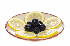 Lemons and olives on the saucer Royalty Free Stock Photos