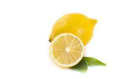Lemons. One and a half lemons on white background royalty free stock photos