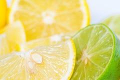 Lemons and orange Stock Images