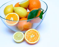 Lemons and Oranges. In a blue toned bowl Royalty Free Stock Photography