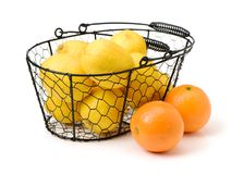 Lemons and oranges. On white background Stock Photos