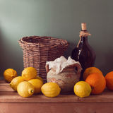 Lemons and oranges on wooden table. Vintage still life composition Royalty Free Stock Photo