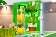 Lemons and other home decorations in glass bowl Royalty Free Stock Photos