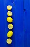 Lemons over blue background Royalty Free Stock Photos