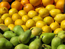 Lemons and Pears. At the market on a sunny day Stock Photography