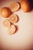 Lemons on pink background Royalty Free Stock Image