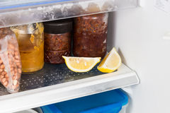 Lemons placed in refrigerator to deodorize bad smell Stock Images