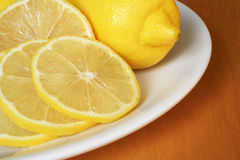 Lemons on the plate. Fresh lemons on the plate royalty free stock image