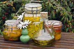 Lemons preserved in oil. Lemons preserved in olive oil on a garden table stock photo