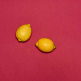Lemons on red background Royalty Free Stock Photography