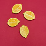 Lemons on red background Stock Images