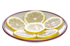 Lemons on the saucer Royalty Free Stock Photos