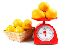 Lemons on scales and in a basket. Stock Images