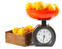 Lemons on scales and in a box Stock Image