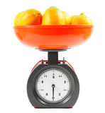 Lemons on scales Royalty Free Stock Photos