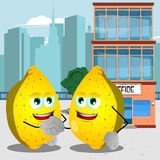 Lemons shaking hands in front of an office building Stock Photography