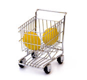 Lemons in shopping cart. Isolated lemons in shopping cart Stock Photo