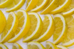 Lemons slices display royalty free stock images
