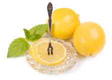 Lemons - slices and fruit on crystal saucer, vintage Fork for le Royalty Free Stock Images