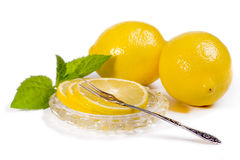 Lemons - slices and fruit on crystal saucer, vintage Fork for le Royalty Free Stock Photo