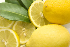 Lemons with slices of lemon and leafes Royalty Free Stock Photo