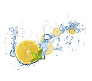 Lemons slices in water splashes on white Royalty Free Stock Photos