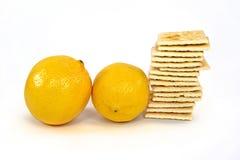 Lemons and soda crackers Royalty Free Stock Photo