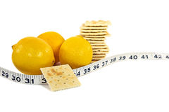 Lemons and soda crackers Stock Images