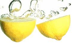 Lemons splashing Stock Images