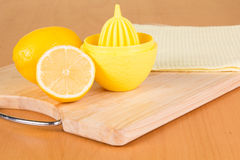 Lemons and squeezer Royalty Free Stock Photo