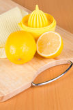 Lemons and squeezer Stock Photo
