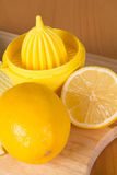 Lemons and squeezer Stock Photos