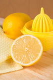 Lemons and squeezer Stock Images
