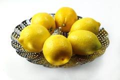 Lemons in a strainer Stock Photo