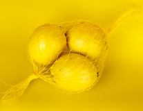 Lemons in a string-bag Royalty Free Stock Images