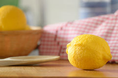 Lemons on a table of a rustic kitchen. Natural light. Stock Images