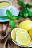 Lemons and tea with mint Stock Photo
